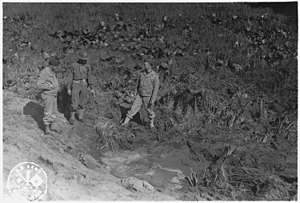 American Theater (World War II) - American servicemen inspecting a shell crater after the Japanese attack on Fort Stevens, Oregon
