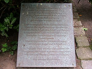 "Marzahn - Inscription on a plate next to the memorial stone on the Marzahn cemetery: ""On a former sewage field North of the cemetery, the Nazis set up a so called ""Zigeunerrastplatz"" (gypsies' resting place) in advance of the 1936 Olympic Games, on which hundreds of Sinti and Roma were forced to live. Crowded into dark shacks, the inhabitants of the camp survived with difficulty. Hard labour, sickness and hunger claimed their victims. At random people were abducted and arrested. Humiliating ""racial hygiene"" examinations spread fear and terror. In the spring of 1943 most of the ""detained people"" were deported to Auschwitz. Men and women, seniors and children. Only a few survived."""