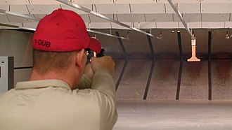 Shooting range - Indoor firing range showing walls, ceiling baffles, and bullet trap