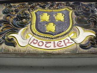 Soufflenheim - Heraldic Potters sign on the outside of a Soufflenheim building