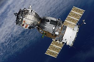 Backdropped by a blanket of clouds, the Soyuz ...