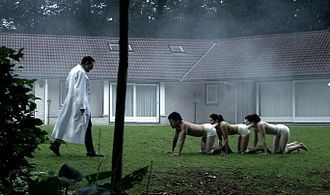 "The Human Centipede (First Sequence) - Dr. Heiter attempts to ""train"" his completed human centipede. The use of bandages in The Human Centipede allowed the filmmakers to imply a more graphic and disturbing idea than is actually shown on screen."