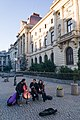 Street musicians near the National Bank of Romania in Bucharest (47981472406).jpg