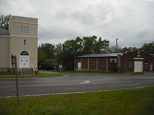 Stull, Kansas - A view of Stull at the intersection of N. 1600 and E. 250 Roads, looking southwest. The building on the left is the former United Methodist Church, and the building on the right is an abandoned store.