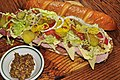 Submarine sandwich with toppings and dijon mustard.jpg