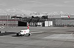Swiss Airbus at Zurich Airport with SR Technic hangar in background.jpg