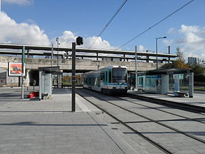 Gennevilliers Station - Tram stop with railway station platforms behind