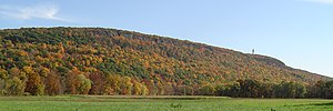 Talcott Mountain - Talcott Mountain cliffs from the Farmington River floodplain. Heublein Tower top right.