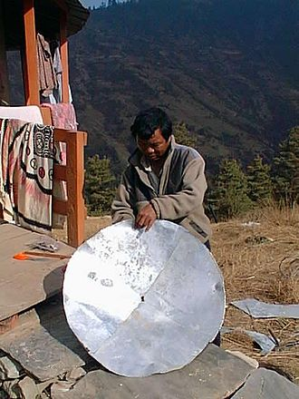 Telecommunications in Nepal - Mahabir Pun hand-making a satellite dish in Nepal