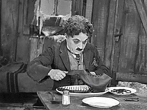 Charlie Chaplin's character, The Tramp, is car...