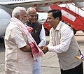 The Prime Minister, Shri Narendra Modi being received by the Governor of Assam, Shri Banwarilal Purohit and the Chief Minister of Assam, Shri Sarbananda Sonowal, on his arrival at Guwahati on August 01, 2017.jpg
