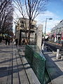 The narrow glass cornerstone of the triangle that is Omotesando Hills (3196187154).jpg