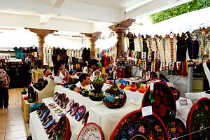 Palm Sunday Handcraft Market - Section of the market selling maque and textiles