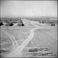 Topaz, Utah. Locking down a main thoroughfare at the Topaz Relocation Center. - NARA - 538677.tif