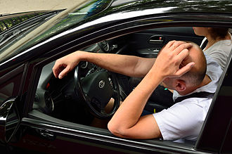 Frustration - A frustrated man sitting in a traffic jam