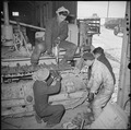 Tule Lake Relocation Center, Newell, California. The treads on a Caterpillar tractor are repaired b . . . - NARA - 536731.tif
