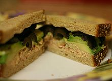 tuna fish sandwich with black olives and avocado