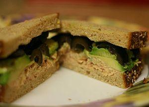 Tuna fish sandwich - A tuna fish sandwich with black olives and avocado