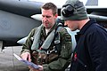 U.S. Air Force Capt. Aaron Schuett, left, chief of mobility with the 493rd Fighter Squadron, speaks to Senior Airman Adam Kipper, a crew chief with the 748th Aircraft Maintenance Squadron, prior to a flying 130118-F-BH151-105.jpg