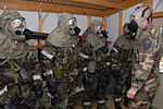 U.S. Air Force Master Sgt. Dwayne Ayers, right, assigned to the 169th Civil Engineer Squadron, gives instructions to Airmen during the gas mask confidence chemical warfare training at McEntire Joint National 080209-F-WT236-008.jpg