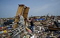 U.S. Air Force Tech. Sgt. Anthony Burch, an avionics equipment specialist with the Air Force Life Cycle Management Center at Tinker Air Force Base, Okla., helps clean up a destroyed home in Moore, Okla., May 24 130524-F-IE715-303.jpg