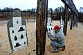 U.S. Air Force Tech. Sgt. Neil Young, a combat arms instructor with the 169th Security Forces Squadron, South Carolina Air National Guard, checks targets on the firing range at McEntire Joint National Guard 131208-Z-WT236-031.jpg