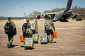 U.S. Air Force aeromedical evacuation team members walk to a C-17 Globemaster III aircraft in preparation for an orientation and training flight March 13, 2014, during Joint Readiness Training Center 14-05 140313-F-XL333-002.jpg