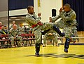 U.S. Army Sgt. Maurice Wilson, an air defense battle management system operator with 5th Battalion, 5th Air Defense Artillery Regiment, 17th Fires Brigade, goes kick for kick with Pvt. Johnny Sichantahvong 130523-A-AU369-664.jpg