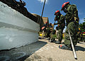 U.S. Marines assigned to the Chemical Biological Incident Response Force extraction team prepare to move a concrete barrier at the Muscatatuck Urban Training Center at Camp Atterbury, Ind., July 29, 2012, during 120729-F-HS649-188.jpg