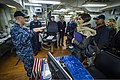 U.S. Navy Cmdr. Jonathan Schmitz, left, the commanding officer of the guided missile destroyer USS Fitzgerald (DDG 62), explains the ship's engineering systems to members of the Council on Foreign Relations 140310-N-ZS026-067.jpg