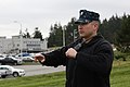 U.S. Navy Master-at-Arms 1st Class Heath Garcia directs traffic away from a security perimeter set around a simulated suspicious package during an anti-terrorism and force protection drill at Naval Air Station 140318-N-DC740-019.jpg
