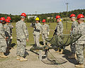 U.S. Soldiers train to assemble and erect an antenna at Fort Gordon, Ga., April 17, 2009 090417-A-NF756-008.jpg