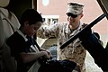 U. S. Marine Cpl. Noah Smith with Combat Logistics Regiment-27, 2nd Marine Logistics Group educates a student from Bitz Intermediate School about a Mine Resistant Ambush Protected vehicle for Career Day 120515-M-KS710-064.jpg