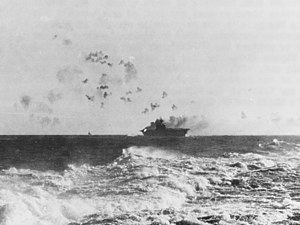 USS Enterprise (CV-6) under attack and burning during the Battle of the Eastern Solomons on 24 August 1942 (NH 97778)