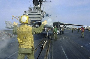 Aircraft catapult - F-14 Tomcat preparing to connect to a catapult on the USS Saratoga (CV-60)