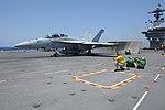 USS Theodore Roosevelt flight deck action 140605-N-OK726-135.jpg