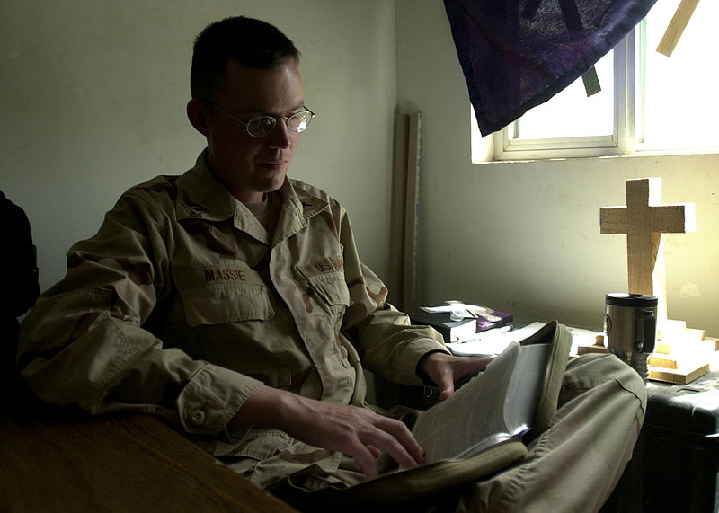File:US Navy 040327-N-1261P-058 Navy Chaplain, Lt. Marc Massie assigned to Naval Mobile Construction Battalion Seventy Four (NMCB-74) studies his Bible for an upcoming service.jpg