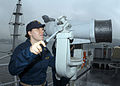US Navy 041013-N-4649C-002 Ens. Alexandria Myers scans the horizon for contacts using the ship's big eyes binoculars as USS Blue Ridge (LCC 19) prepares to get underway for the first time after a six-month dry dock period.jpg