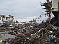 US Navy 050101-O-XXXXB-081 Trash and debris line the streets in down town Aceh, Sumatra following a massive Tsunami that struck the area on the 26th of December 2004.jpg