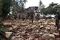 US Navy 050116-N-6843I-018 U.S. Navy Seabees assigned to Naval Mobile Construction Battalions Seven (NMCB-7), survey the site of a schoolhouse destroyed by the Dec. 26th Tsunami in the village of Koggala, Sri Lanka.jpg