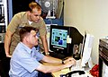 US Navy 050307-N-0879R-001 Lt. Andrew Neboshynsky and Operations Specialist 1st Class Troy Tyson monitor Anti-Submarine Warfare (ASW) activity in the Pacific using the Navy's Maui High Performance Computing Center (MHPCC).jpg