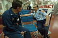 US Navy 050323-N-8629M-032 Commanding Officer, Medical Treatment Facility, Capt. David Llewellyn, left, speaks with Indonesian Surgeon General, Brig. Gen. A. Hidayat, upon his arrival aboard the Military Sealift Command (MSC) h.jpg