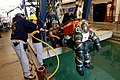 US Navy 050503-N-1397H-102 Deep Submergence Sailors assigned to Naval Air Station (NAS) North Island and civilian joint operation team members assist launching Lt. Cmdr. Keith Lehnhardt in an Atmospheric Dive Suit.jpg