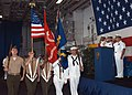US Navy 050624-N-3557N-009 Officers salute as the colors are paraded during a change of command ceremony held in the hangar bay.jpg