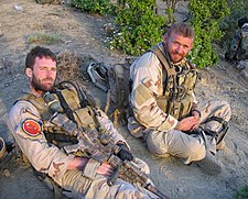 US Navy 050628-N-0000X-005 Navy file photo of SEAL Lt. Michael P. Murphy, from Patchogue, N.Y., and Sonar Technician (Surface) 2nd Class Matthew G. Axelson, of Cupertino, Calif., taken in Afghanistan