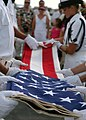 US Navy 050707-N-8937A-084 Several members of the U.S. Pacific Fleet Honor Guard ceremoniously fold the U.S. flag during a burial at sea aboard the USS Arizona Memorial.jpg