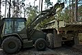 US Navy 050915-N-3879H-005 U.S. Navy Seabees assigned to Naval Mobile Construction Battalion One (NMCB-1), removes downed trees at Flint Creek Water Park using a front-end loader.jpg