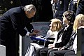 US Navy 060404-N-0696M-279 Secretary of Defense Donald H. Rumsfeld expresses his condolences to Jane Weinberger, wife of the late Caspar W. Weinberger, at the funeral for her husband at Arlington National Cemetery.jpg