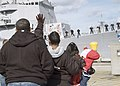 US Navy 060406-N-8825R-032 Guided-missile destroyer USS Momsen (DDG 92) Sailors man the rails as families and friends wave good-bye.jpg