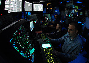 Air traffic controller - A military air traffic controller works approach control in Carrier Air Traffic Control Center (CATTC) aboard the Nimitz class aircraft carrier USS Abraham Lincoln (CVN 72).